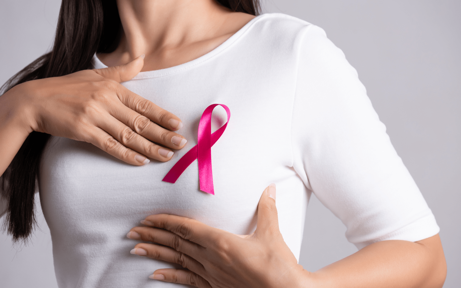 Woman with a breast cancer pin